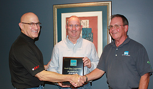 Mark Byrne, IBT President/CEO and Mike Muenks, General Industrial Product Group Business Director, accept the Koch Filter President's Award from Dick Ballard, Koch Filter District Manager.